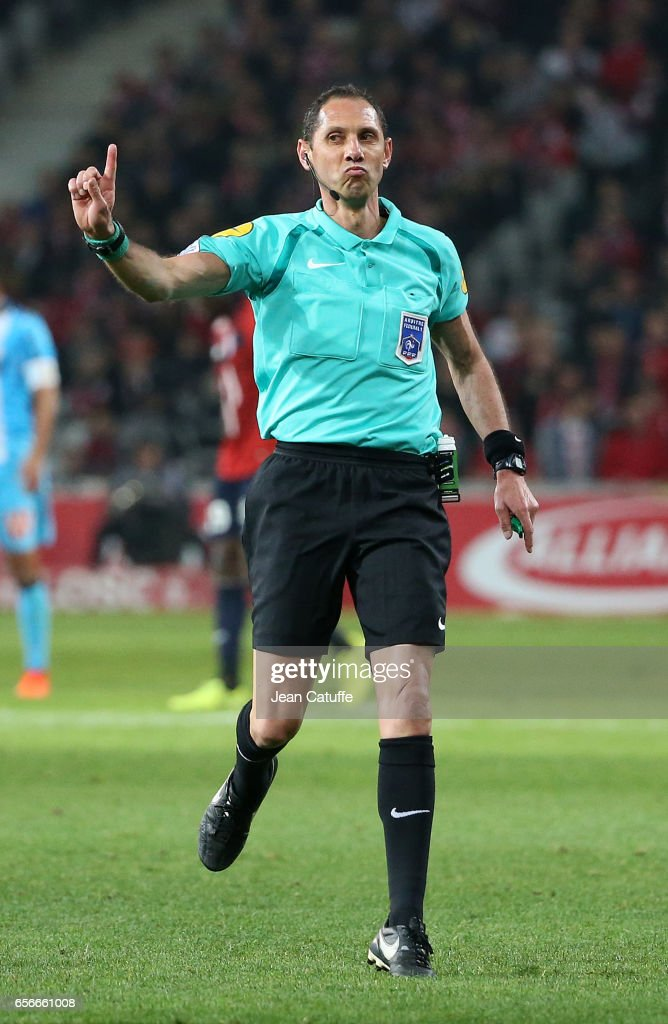 Referee Mikael Lesage gestures during the French Ligue 1 match between Lille OSC (LOSC) and Olympique de Marseille (OM) at Stade Pierre-Mauroy on March 17, 2017 in Lille, France.