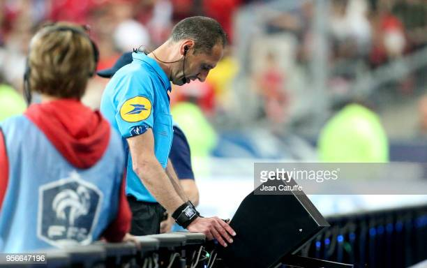 Referee Mikael Lesage is using the video assistance during the French Cup final between Les Herbiers VF and Paris SaintGermain at Stade de France on...