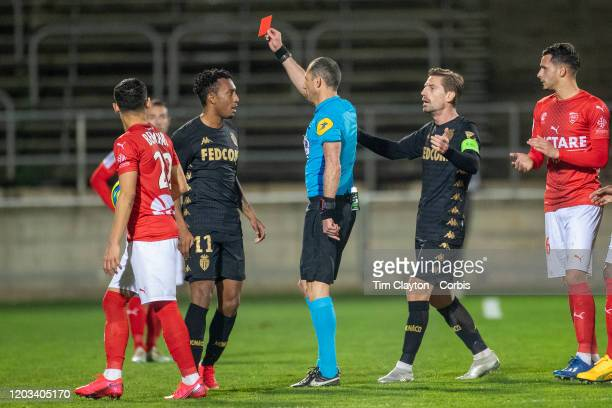 Referee Mikael Lesage shows a red card to Gelson Martins of Monaco during the Nimes V Monaco French Ligue 1 regular season match at Stade des...