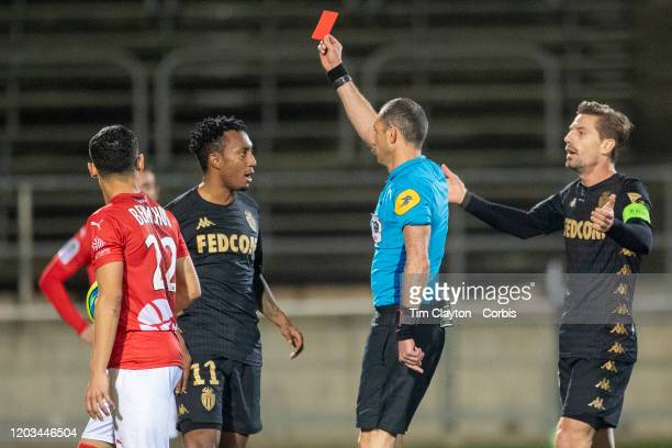 February 01: Referee Mikael Lesage shows a red card to Gelson Martins of Monaco during the Nimes V Monaco, French Ligue 1, regular season match at...