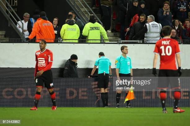 Referee Mikael Lesage uses the video during the French League Cup match between Stade Rennais and Paris Saint Germain at Roazhon Park on January 30...