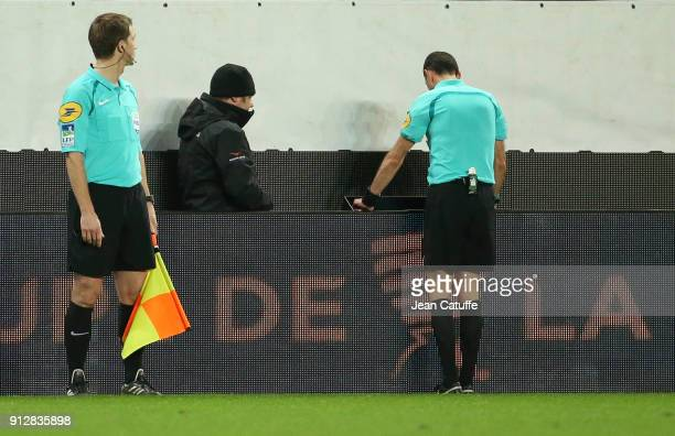 Referee Mikael Lesage uses the video to take a decision during the French League Cup match between Stade Rennais and Paris Saint Germain at Roazhon...