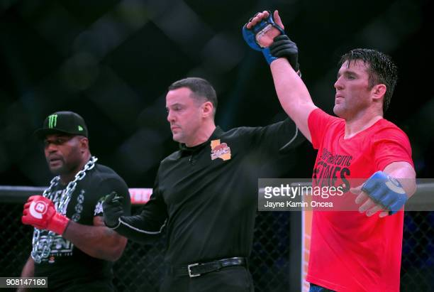 Referee Mike Beltran raises the arm of Chael Sonnen as he defeated Quinton Jackson in their Heavyweight World Title fight at Bellator 192 at The...