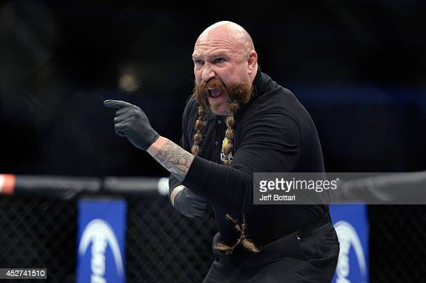 Referee Mike Beltran signals the start between Julianna Lima and Joanna Jedrzejczyk in their women's strawweight bout during the UFC Fight Night...