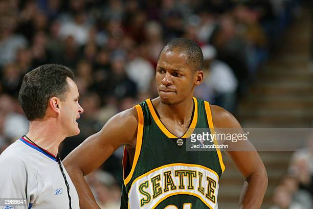 Referee Mike Callahan talks to Ray Allen of the Seattle Sonics during the game against the Sacramento Kings at Arco Arena on February 3 2004 in...