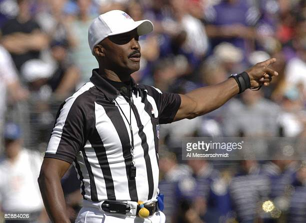 Referee Mike Carey calls a penalty at M&T Bank Stadium as the Baltimore Ravens host the San Diego Chargers on October 1, 2006 in Baltimore, Maryland....
