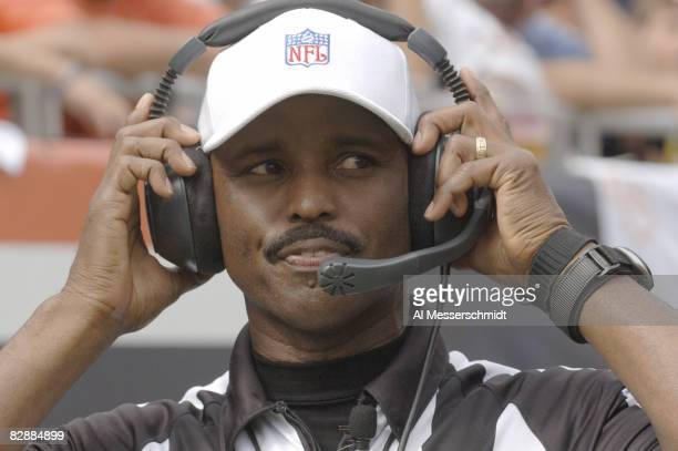 Referee Mike Carey checks the replay screen during a game between the Chicago Bears and Detroit Lions at Soldier Field in Chicago, Illinois on...