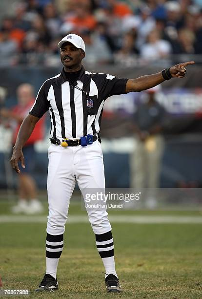 Referee Mike Carey gestures as he makes a call during the NFL game between the Chicago Bears and the Kansas City Chiefs at Soldier Field on September...