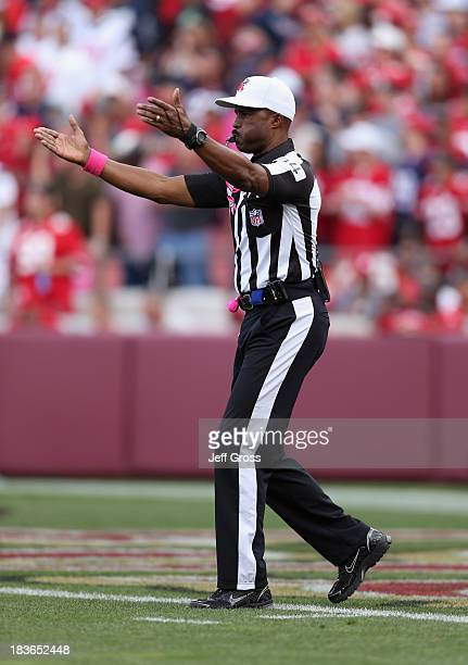 Referee Mike Carey makes a call during the game between the Houston Texans and the San Francisco 49ers at Candlestick Park on October 6, 2013 in San...
