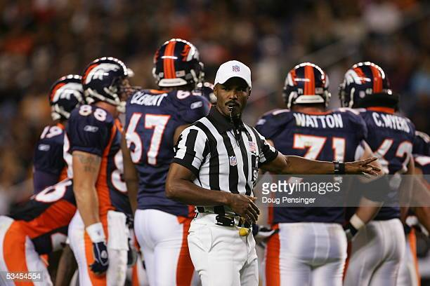 Referee Mike Carey of the Denver Broncos makes a call during the preseason game with the San Francisco 49ers at Invesco Field at Mile High on August...