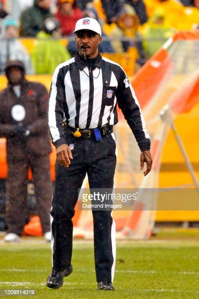 Referee Mike Carey on the field in the first quarter of a game between the Cleveland Browns and Pittsburgh Steelers on December 29, 2013 at Heinz...