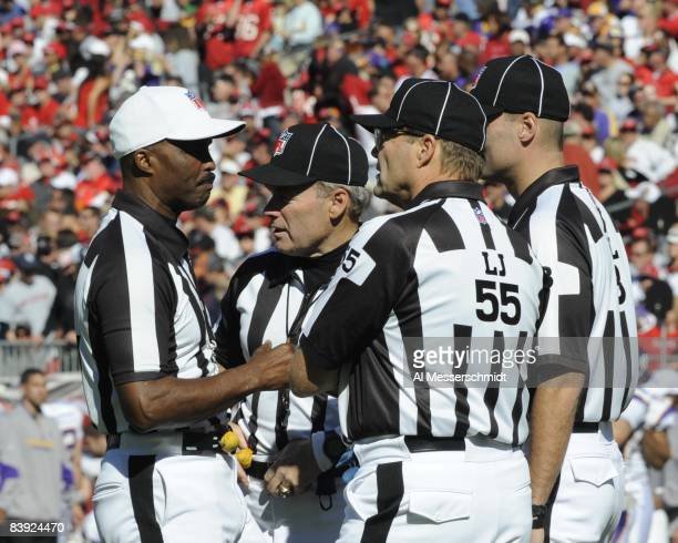 Referee Mike Carey reviews a play as the Tampa Bay Buccaneers host the Minnesota Vikings at Raymond James Stadium on November 16, 2008 in Tampa,...
