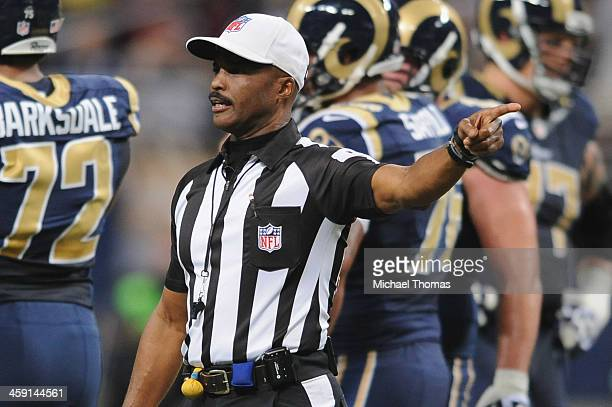 Referee Mike Carey signals during a penalty call during a game between the St. Louis Rams and the New Orleans Saints at the Edward Jones Dome on...