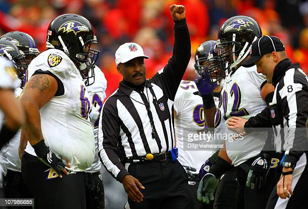 Referee Mike Carey signals during the 2011 AFC wild card playoff game between the Kansas City Chiefs and the Baltimore Ravens at Arrowhead Stadium on...