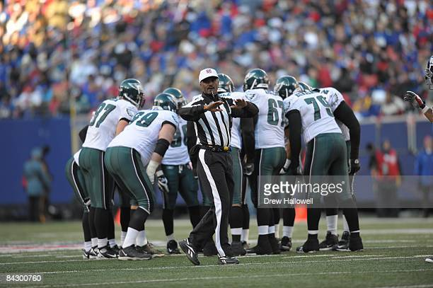 Referee Mike Carey signals during the game between the Philadelphia Eagles and the New York Giants on January 11, 2009 at Giants Stadium in East...