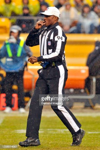 Referee Mike Carey signals the start of play in the first quarter of a game between the Cleveland Browns and Pittsburgh Steelers on December 29, 2013...