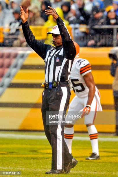 Referee Mike Carey signals the start of play in the second quarter of a game between the Cleveland Browns and Pittsburgh Steelers on December 29,...