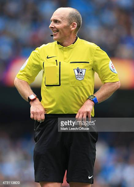 Referee Mike Dean adjusts his shorts during the Barclays Premier League match between Manchester City and Queens Park Rangers at the Etihad Stadium...