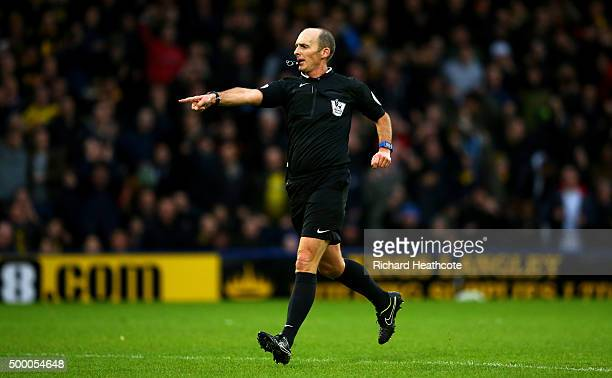 Referee Mike Dean awards a penalty during the Barclays Premier League match between Watford and Norwich City at Vicarage Road on December 5 2015 in...
