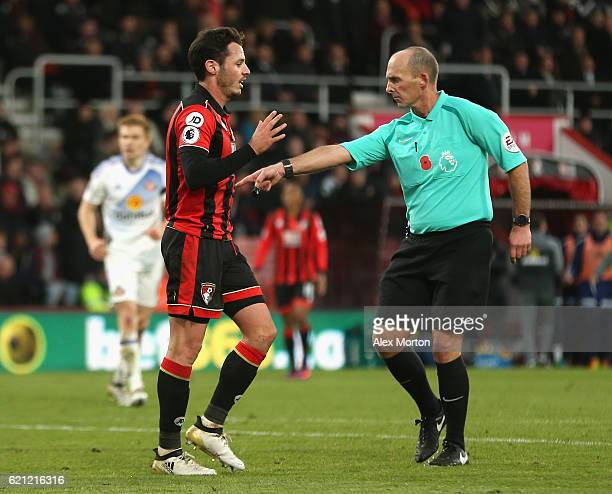 Referee Mike Dean awards a penalty to Sunderland and Adam Smith of AFC Bournemouth reacts during the Premier League match between AFC Bournemouth and...