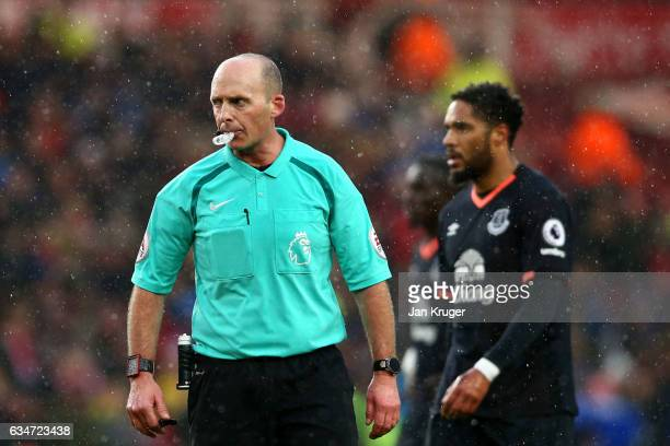 Referee Mike Dean blows a bubble during the Premier League match between Middlesbrough and Everton at Riverside Stadium on February 11 2017 in...