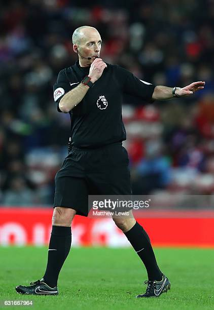 Referee Mike Dean blows his whistle during the Premier League match between Sunderland and Stoke City at Stadium of Light on January 14 2017 in...