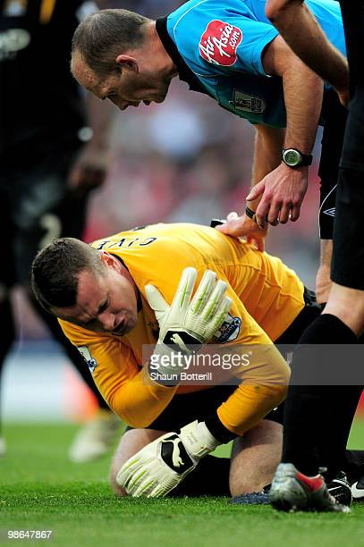 Referee Mike Dean checks on Shay Given of Manchester City after he injures his shoulder during the Barclays Premier League match between Arsenal and...