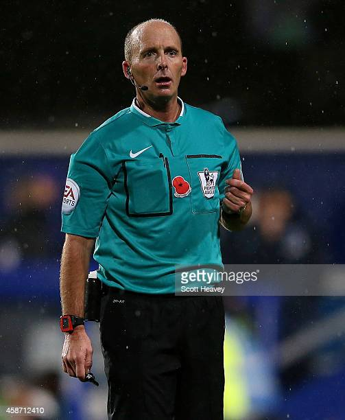 Referee Mike Dean during the Barclays Premier League match between Queens Park rangers and Manchester City at Loftus Road on November 8 2014 in...