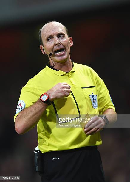 Referee Mike Dean during the Barclays Premier League match between Arsenal and Manchester United at Emirates Stadium on November 22 2014 in London...