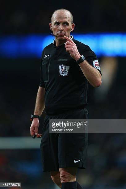 Referee Mike Dean during the Barclays Premier League match between Manchester City and Arsenal at the Etihad Stadium on January 18 2015 in Manchester...