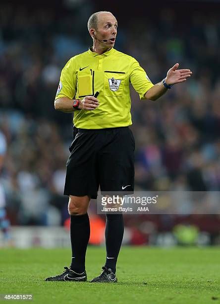 Referee Mike Dean during the Barclays Premier League match between Aston Villa and Manchester United at Villa Park on August 14 2015 in Birmingham...