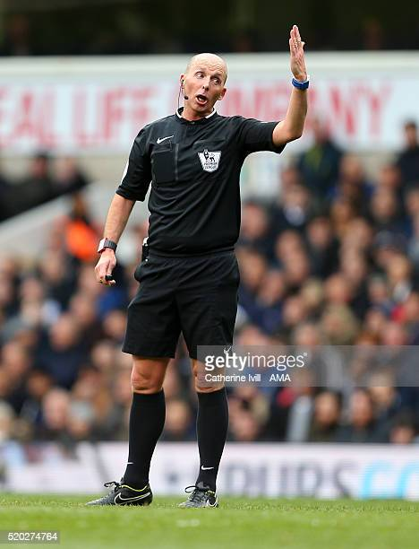 Referee Mike Dean during the Barclays Premier League match between Tottenham Hotspur and Manchester United at White Hart Lane on April 10 2016 in...