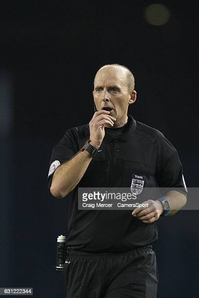 Referee Mike Dean during the Emirates FA Cup Third Round match between Tottenham Hotspur and Aston Villa at White Hart Lane on January 8 2017 in...