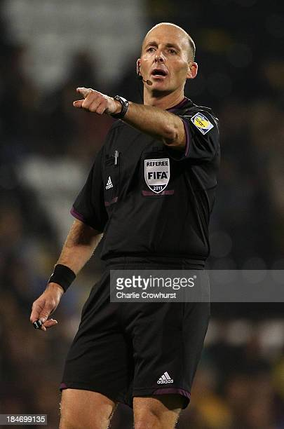 Referee Mike Dean during the International Friendly match between Canada and Australia at Craven Cottage on October 15 2013 in London England