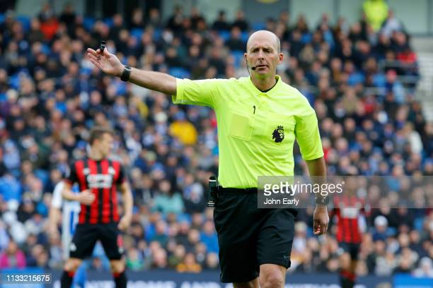Referee Mike Dean during the Premier League match between Brighton Hove Albion and Huddersfield Town at American Express Community Stadium on March...