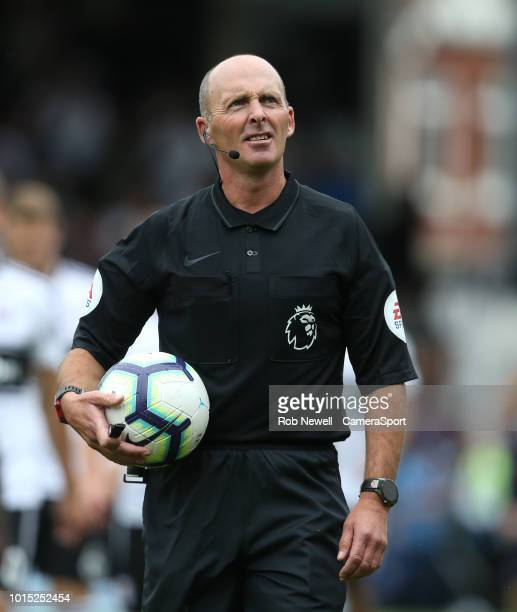 Referee Mike Dean during the Premier League match between Fulham FC and Crystal Palace at Craven Cottage on August 11 2018 in London United Kingdom