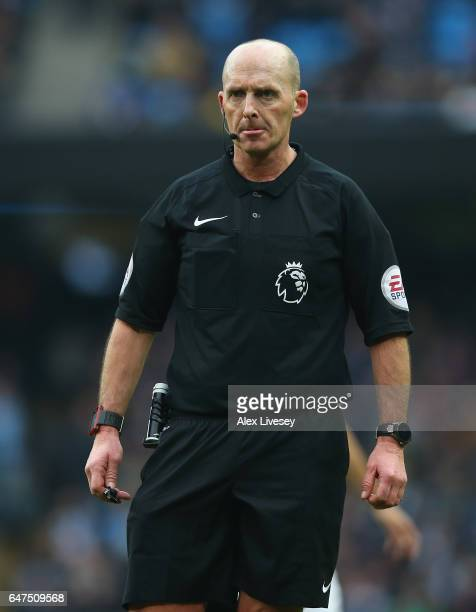 Referee Mike Dean during the Premier League match between Manchester City and Swansea City at Etihad Stadium on February 5 2017 in Manchester England