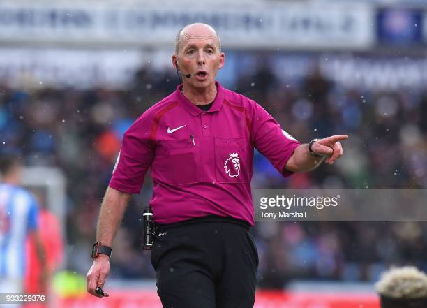 Referee Mike Dean during the Premier League match between Huddersfield Town and Crystal Palace at John Smith's Stadium on March 17 2018 in...