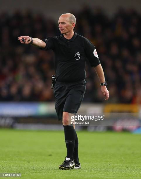Referee Mike Dean during the Premier League match between Wolverhampton Wanderers and Manchester United at Molineux on April 02 2019 in Wolverhampton...