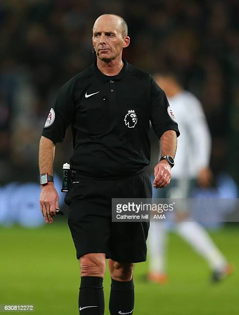 Referee Mike Dean during the Premier League match between West Ham United and Manchester United at London Stadium on January 2 2017 in Stratford...
