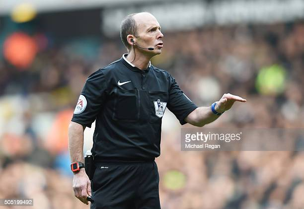 Referee Mike Dean gestures during the Barclays Premier League match between Tottenham Hotspur and Sunderland at White Hart Lane on January 16 2016 in...