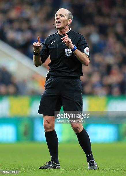 Referee Mike Dean gestures during the Barclays Premier League match between Newcastle United and Manchester United at St James' Park on January 12...