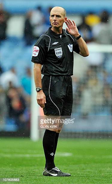 Referee Mike Dean gestures during the English Premier League football match between Aston Villa and Bolton Wanderers at Villa Park Birmingham West...