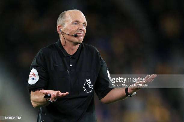 Referee Mike Dean gestures during the Premier League match between Wolverhampton Wanderers and Manchester United at Molineux on April 2 2019 in...