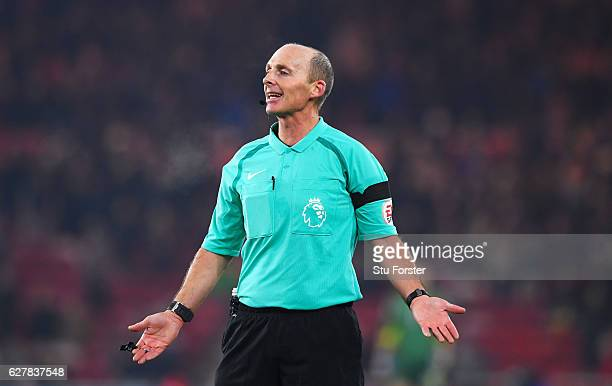 Referee Mike Dean gestures during the Premier League match between Middlesbrough and Hull City at Riverside Stadium on December 5 2016 in...