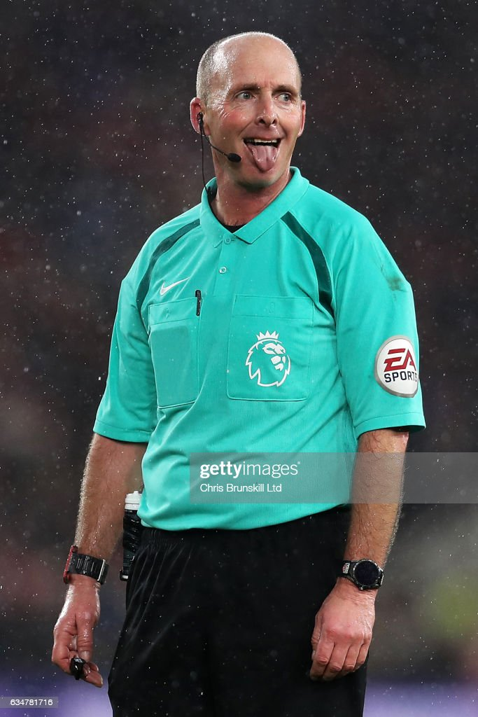 Referee Mike Dean gestures during the Premier League match between Middlesbrough and Everton at Riverside Stadium on February 11, 2017 in Middlesbrough, England.