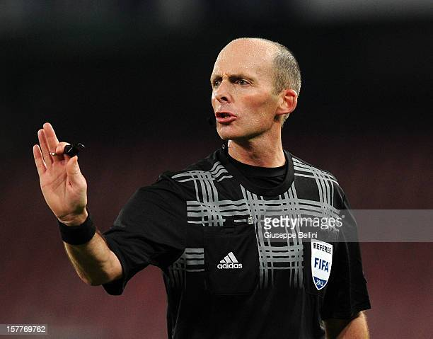 Referee Mike Dean gestures during the UEFA Europa League Group F match between SSC Napoli and PSV Eindhoven at Stadio San Paolo on December 6 2012 in...