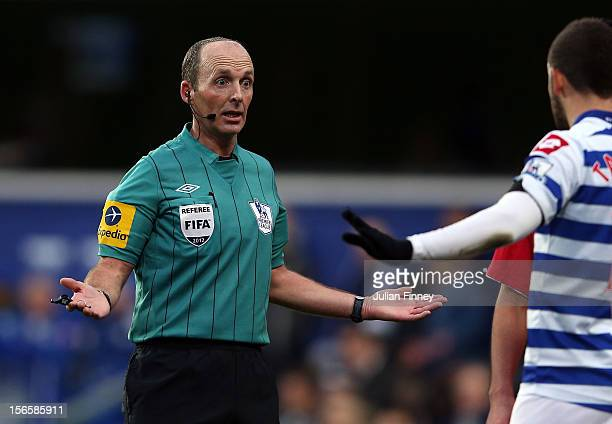 Referee Mike Dean gives a decision during the Barclays Premier League match between Queens Park Rangers and Southampton at Loftus Road on November 17...
