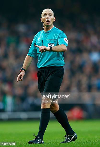 Referee Mike Dean in action during the Barclays Premier League match between West Ham United and Newcastle United at Boleyn Ground on November 29...