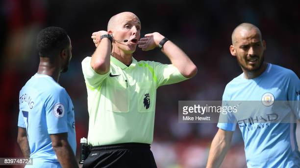 Referee Mike Dean in action during the Premier League match between AFC Bournemouth and Manchester City at Vitality Stadium on August 26 2017 in...
